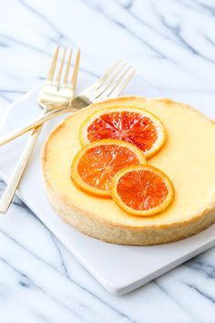 Orange Blossom Almond Cream Tart for Two topped with candied orange slices http://www.dailyquinoa.com