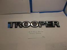 92-99 Isuzu Trooper Side fender emblem OEM Nameplate Script M6  #Isuzuoemfactorygenuinestock