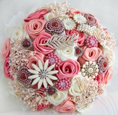 Brooch bouquet. Deposit on a Coral, Ivory and Gold wedding brooch bouquet, Jeweled Bouquet. Made upon request. $60.00, via Etsy.