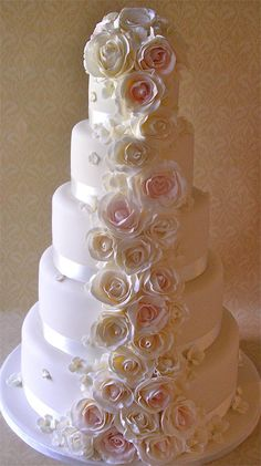 a 5 tier wedding cake with blush pink and ivory cascading roses.    http://www.niceicing.com
