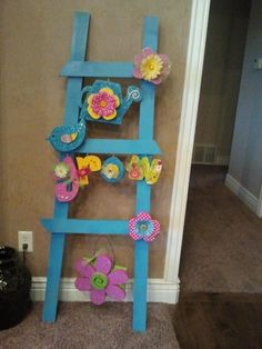 I made this ladder for Spring and Easter. You can switch out the letters ect and add seasonal items to it. So FUN !