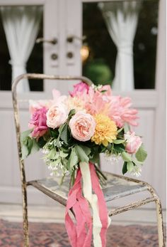 Wild and romantic bouquet with giant coral peonies and garden roses