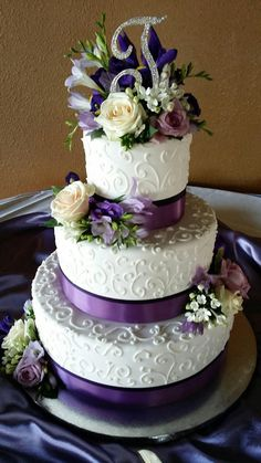 Wedding cakes with fresh purple and white flowers