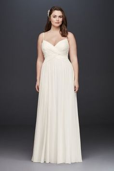 A sweet and simple wedding dress, perfect for a beach ceremony or garden soiree. This flowing chiffon plus-size gown features an elegantly ruched sweetheart bodice topped with spaghetti straps and a long soft A-line skirt. David's Bridal Collection Plus size Polyester Sweep train Back zipper; fully lined Dry clean Imported Also available in regular, extra length and plus size extra length
