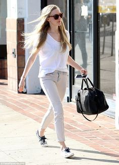 Sunny walk: Amanda Seyfried looked lovely in casual clothes while taking a walk in the trendy neighbourhood