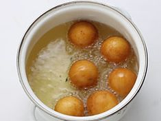 Soft, spongy and melt in mouth gulab jamuns drenched in syrup is a traditional homemade sweet. This recipe uses khoya and saffron flavored syrup for more rich and delighting taste, texture and flavor. Easy Indian Dessert Recipes, Indian Desserts, Sweets Recipes, Jamun Recipe, Clarified Butter Ghee, Gulab Jamun, Dried Rose Petals, Non Stick Pan, Shredded Coconut