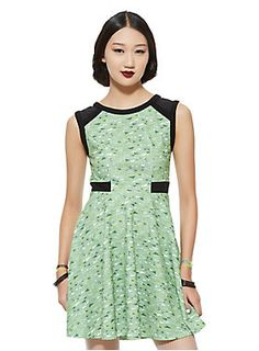 """<p>Transform into the toughest fighter aka Buttercup in this dress from the Hot Topic exclusive Powerpuff Girls collection. The design is inspired by her costume with a green and white triangle print all over, black hip trim and mesh shoulder straps. Back zipper closure. Now you're ready to save the world... before bedtime!</p>  <ul> <li>33"""" long</li> <li>96% polyester; 4% spandex</li> <li>Wash cold; dry low</li> <li>Imported</li> </ul>"""
