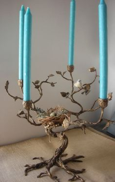 Twig candelabra with nest and egg (from Anthropologie) - On my wish list! Light Art, Chandeliers, Deco Luminaire, Deco Nature, Blue Candles, French Interior, Wire Art, My Favorite Color, Candlesticks