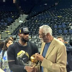 LeBron James has a moment with Bill Russell after his MVP performance in Oakland.