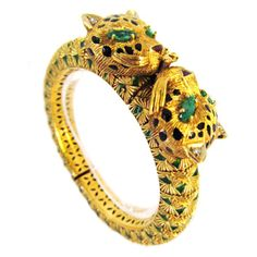 Spectacular Double Leopard Head Gold Bracelet | From a unique collection of vintage cuff bracelets at http://www.1stdibs.com/jewelry/bracelets/cuff-bracelets/