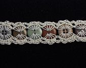 crochet button bracelet - inspiration picture!! such a special and easy-to-make piece of jewlery!