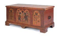 """Realized Price: $33,180     Berks County, Pennsylvania painted pine chest, late 18th c., the front decorated with two rampant unicorns flanked by tombstone panels with tulips, 23 1/4"""" h., 48 1/2"""" w."""