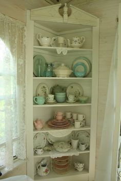 Cottage cupboard with a mix of dishes.
