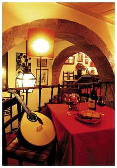 """The Restaurante """"Clube de Fado"""" is in the heart of Alfama and just a """"stone's throw away"""" of the renowned Sé de Lisboa. If you enjoy excellent Portuguese traditional cooking, the sound of a Portuguese Guitar and to hear the greatest portuguese Fado voices, this Fado club is for you. As you enter the doors of Clube de Fado, you immediately feel a different atmosphere: Warm, romantic, almost mystical!"""