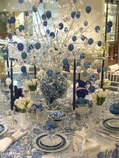 white blue glittery christmas dinner table decorations focusing on blue and white gittery christmas balls on