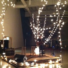 Vintage stage: pallets, rugs, trees and lights-the stage I have told the girls they need to dance on....
