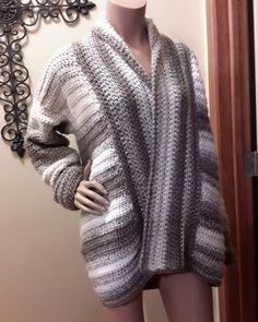 This pattern is easily adjusted to fit any size. Sweater is worked from the bottom up and in flat pieces.
