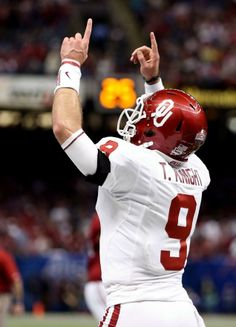 Trevor Knight points to the heavens as he throws for four touchdown passes to lead the Sooners past Alabama in the Sugar Bowl.