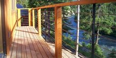 Photo Gallery of Ultra-tec stainless steel cable railing products used in cable deck railing with wood or metal posts Metal Deck Railing, Deck Railing Systems, Exterior Handrail, Stainless Steel Cable Railing, Gates And Railings, Under Decks, Cottage Exterior, Banisters, Outdoor Fun