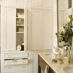 Include a Linen Closet    It's unlikely that you'll ever hear someone complain about having too much storage. Here, plentiful linen and toiletry storage is integrated into a large wall in the master bath. Master Baths | Include a Linen Closet | SouthernLiving.com