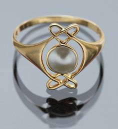 Attributed To Archibald Knox, Murrle Bennett & Co Ring, pearl and gold, circa 1900
