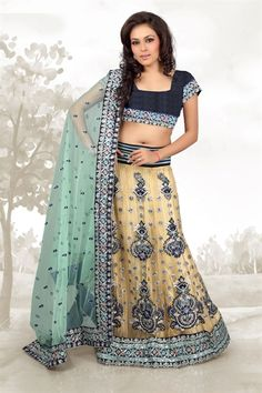 Green & Beige Lehenga - I would probably eliminate the stripes at the top of the lehenga and lengthen the choli - have it be green velvet instead