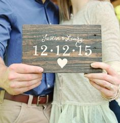 "Rustic sign made of reclaimed wood. Stained and hand painted by brush with your personalized names and wedding date. Hanging hardware comes installed. Please include names and date when ordering. Dimensions: 1. Approx. 8"" x 5.5"""