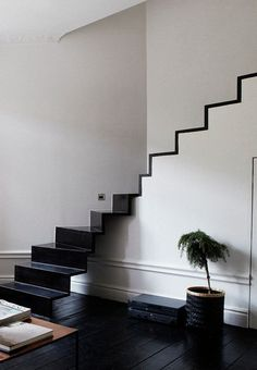 Nice and modern proposal for metal stairs.  Love this staircase, open lower part.  Open to metal vs wood to match rest of flood.  Wide trim boards painted to match white walls.  Add seamless glass wall and simple railing on back wall.
