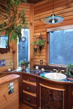 Straw Bale home in Colorado ~ Bathroom. Salvaged wood planks give the bathroom a sauna feel, Mosaic countertop out of scrap stained glass pieces.  (<3)