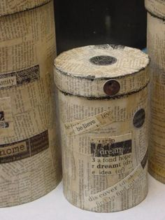 finished oatmeal boxes covered with book pages - make these for studio supplies