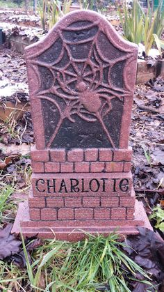 """Charlotte, the spider from """"Charlotte's Web"""", was a combination of a Dollar Tree tombstone and an additional base added to it. She remains in repose as a part of our Pet Sematary. Halloween Forum, Halloween Stuff, Tombstone Epitaphs, Holiday Competitions, Pet Sematary, Pop Up Window, Charlotte's Web, Yard Ideas, Dollar Tree"""