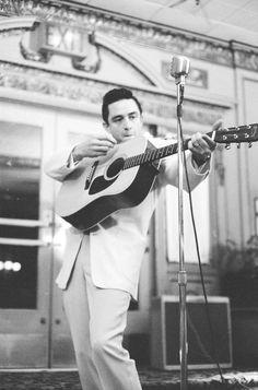 Cash. Using guitar as a shotgun.
