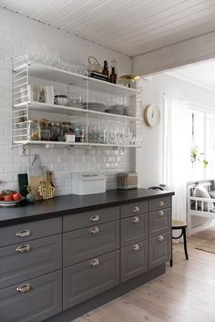 The grey cabinets are so pretty but that awful shelf makes what could be a gorgeous kitchen look REALLY cheap. And dated. Grey Kitchen Cabinets, Kitchen Shelves, Kitchen Countertops, Kitchen Dining, Kitchen Decor, Apartment Kitchen, Apartment Interior, Interior Design Kitchen, Interior Decorating