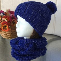 Glitter Blue Winter Pompom Hat This blue winter hat is available today, but can be made custom in any color or size you like.  Can be worn as a slouch or cuffed at the brim. Order today. Amanda DePastino Accessories Hats