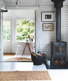 Wood burner in front of painted shiplap