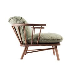 Neo Shaker Lounge Chair. This Shaker inspired lounge chair was made by a traditional furniture maker in Delaware. The contrast of the reclaimed shelter half army canvas gives a modern twist to this traditional chair.