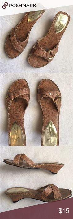 Brown Cork Sandals Cute cork sandals with gold accent. Good used condition. No box. A small scuff on each heel ( see last picture) Size 7. Soft Style by Hush Puppies. Hush Puppies Shoes Sandals