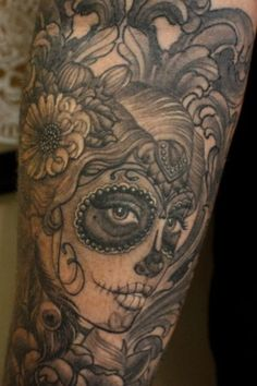 a sugar skull similar to this, maybe with some colour, at the top of my arm, i don't really like the style of the flower in her hair, but wondered about having something more rose like, and really like the peacock feathers