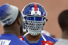 I'd be scared looking across the line at this - New York Giants defensive end Justin Tuck shows off his new facemask during mini-camp. Jim O'Connor-US PRESSWIRE Nfl Football Helmets, Sports Helmet, Sport Football, Sports Teams, College Football, American Football League, National Football League, Justin Tuck, New York Giants Football