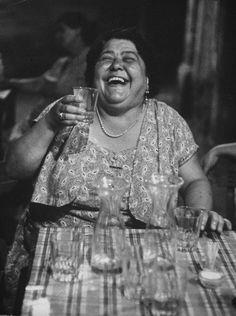 Roman lady Mrs Luisa Pierotti lofting a near empty glass of wine. She looks quite happy! By Carlo Bavagnoli.
