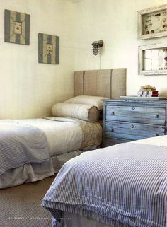 This bright bedroom gives off the air of a beach-side cottage. With linen headboards and striped bedspreads, the nautical theme is carried throughout the room. A faded blue dresser and distressed frames complete the cottage bedroom. Burlap Headboard, Grey Headboard, Home Bedroom, Bedroom Decor, Bedroom Frames, Beach Cottage Decor, Cottage Living, Cottage Style, Romantic Homes