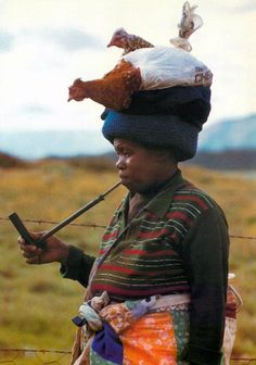 "Africa | ""The long stemmed pipe is traditional to the Xhosas ... where a bird in the hand is perhaps not quite as practical as having some chickens on the mind"".  South Africa 