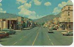 1950's CARS CANON CITY COLORADO DOWNTOWN MAIN STREET SCENE VINTAGE POSTCARD COLO
