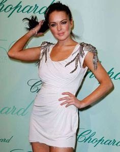 Lindsay Lohan in a Torn Dress Makes for a High Society Disaster #lindsaylohan #celebrities trendhunter.com