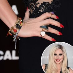 Ke$ha: Normally outlandish Ke$ha went for a classic crimson manicure at the Calzedonia Summer trunk show.