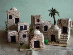 casitas - no tutorial, not for sale at this link - just inspiration: what kind of clay would make these best? use slab technique? coat with dry powdered form of clay or etc. before painting? Christmas Nativity Scene, Christmas Villages, Christmas Holidays, Christmas Crafts, Pottery Houses, Jesus Birthday, Miniature Houses, Fairy Houses, Xmas Decorations