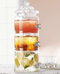 Stacked beverage server dispenses three beverages in the footprint of one.