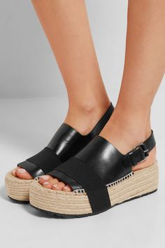 Wedge heel measures approximately 60mm/ 2.5 inches with a 50mm/ 2 inches platform Black leather Buckle-fastening slingback strap Made in Spain