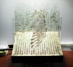 Glass Sculpture Rotates to Reveal 4 Hidden Anamorphic Paintings