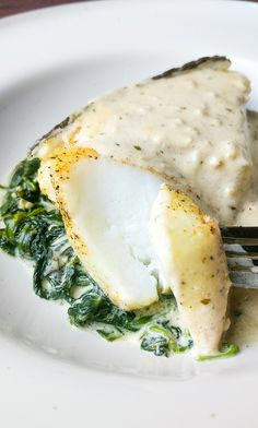 Did someone say Foil Baked Chilean Sea Bass with Lemon Parmesan Cream Sauce? Making this delicious Chilean Sea Bass in foil along with garlic cream spinach served topped with a. Sauce Recipes, Fish Recipes, Seafood Recipes, Cooking Recipes, Healthy Recipes, Chicken Recipes, Fish Dishes, Seafood Dishes, Tasty Dishes